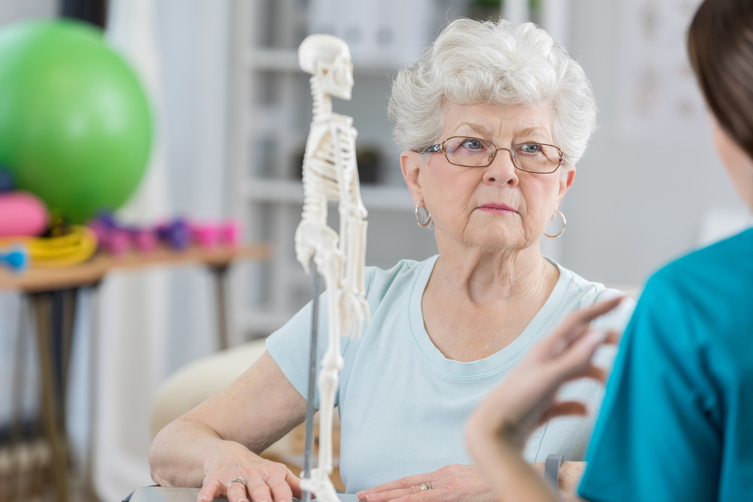 Patient with Osteoporosis Discusses Bisphosphonate Infusion with a Specialist in Auckland clinic.